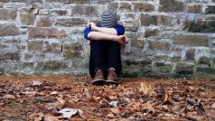 Pixabay - Boy sitting on ground leaning against brickstone wall