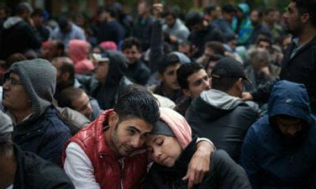 Migranten schuiven aan in Berlijn, Duitsland om zich te registreren. Photo: UNICEF/Ashley